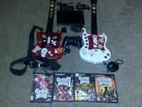 I am selling a slim PS2 w / a Guitar Hero, 15 video