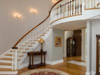 Now offering spectacular custom home located in the