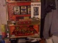 Slot machine in good shape for sale. Includes over 300