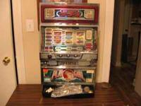 Slot Machine/Uses tokens or quarters $300.00 Call  or