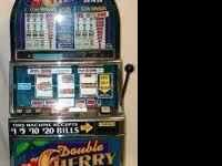 THIS IS A WORKING NICKLE DOUBLE CHERRY SLOT MACHINE