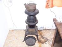 Antique cast iron belly kitchen stove (3' tall) with