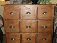 5 drawer apothecary cabinet with metal hardware.