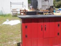 RED AND BLACK BAR     HAS STORAGE SHELVE    HAVE BAR