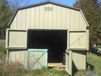 This is a small barn or a very large storage shed. It