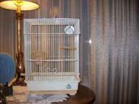 Nice small bird cage,16in. in height and 11 in. wide,