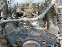 Small block Chevy parts: TBI intake 193 heads water