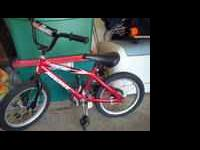 Hello, we have a small boys bike (red & black) for