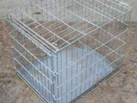 I have this wire cage, well made. It has on door, and a