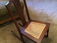 Sweet rocking chair with newer cane seat. No arms , not