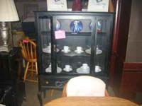 Used Nice small black china cabinet If interested