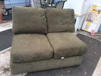 Green armless couch