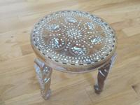 I have a beautiful inlaid decorative table from India.