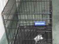 Black metal cage for a small dog. Call  if interested.