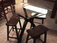 Small glass top wood table and chairs in good
