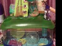 we have a small hamster cage for sale,it has a door on