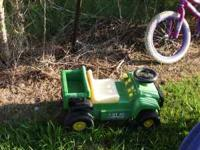 This is a small john deere gator ride toy. Not