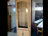 Made all out of oak. The doors and molding are trimmed