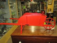 Here is a great small red Paris wheelbarrow. Perfect