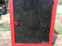 This cabinet features a door, that can be locked, and