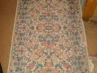 We are selling a wonderful wool Low Pile Area Rug We