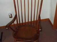 Solid wood antique rocker has accompanying reversible,