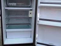 Small Brown Fridge.  10.3 Cubit Ft  . Size= 30 inches