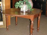 "Vintage drop side dining table. Measures 57"" long x 44"""