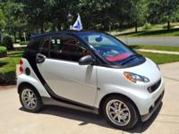 This is a 2010 Model Smart Car Passion for two in