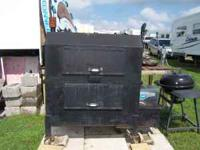 Huge steel smoker/grill on wheels - easy to move great
