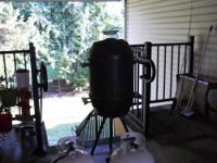 1 smoker with tank. black in color and it is propane