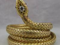 This is a yellow gold snake/serpent bracelet. The head