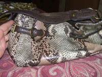 I LOVE THIS PURSE IT IS SNAKE SKIN JESSICA SIMPSON VERY