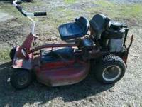 10hp B&s engine electric start. 33 in deck. smokes $175