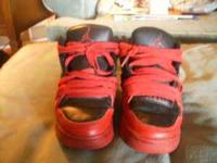 I have a pair of boys, black and red Jordan sneakers.