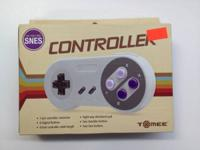 Tomee Super Nintendo (SNES) Controller. New. Price: