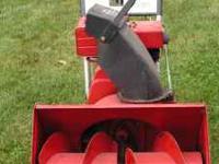 Older single stage Toro snow blower. It has three