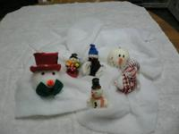 A Variety of Snow People Snow people that are stuffed