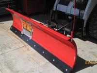 THIS IS AN 8' PLOW ATTACHMENT FOR A SKIDSTEER. IT HAS