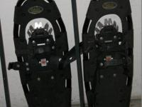 Alaskan Guide 9 X 30 Snow Shoes with walking sticks.