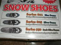 11 pairs of Yukon Charlies snowshoes and 1 pair of