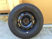 Studded snow tires 205/70r15 mounted on 5 lug wheels.