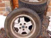 Four used snow tires mounted on four Volvo turbo