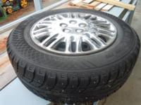 Set of 4 Aurora P205/65R15 studded snow tires with