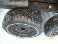 here is a set of like new snow tires foe a buick