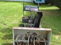 "White 10 HP snowblower, runs great with 30"" x 21"" high"
