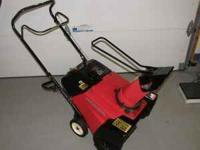 "Honda 4 Stroke engine with a 21"" wide path.  Location:"