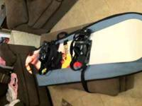 """Ride"" Snowboard, 148 mm in good shape with case. Has a"
