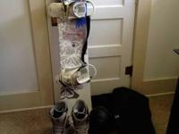 Complete package of snowboard and snowboard gear.  Blue