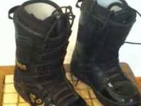 2 pairs of thirtytwo snowboarding boots. First pair are